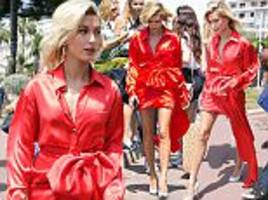 hailey baldwin flaunts her legs in bright red satin dress