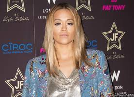 rita ora flaunts ample cleavage in plunging mini dress at de grisogono party in cannes