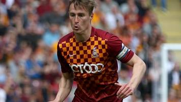 bradford city: stephen darby released but six offered new deals