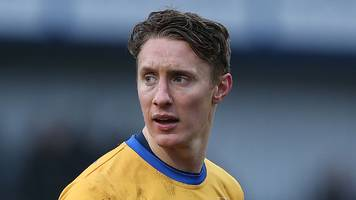 martin riley: halifax sign defender on one-year deal following release by wrexham