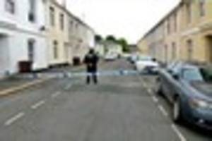 Man arrested over stabbing remains in police custody