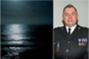 policeman hailed a hero for wading into 'dangerous' sea at night...