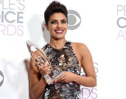 Priyanka Chopra stuns in flirty dress as she stops by Extra studio in Hollywood to promote upcoming comedy Baywatch