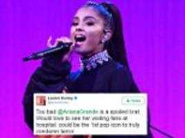 Ariana Grande is targeted by trolls over postponed tour