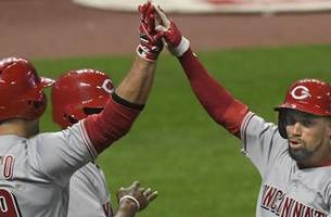 hamilton scores from first on single to lift reds in 9th