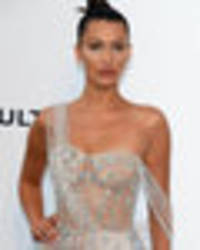 bella hadid teams diamonds with nudity in barely-there gown
