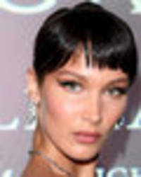 bella hadid teases yet another crotch flash in high-slit dress