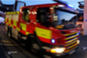 Fire crews tackle tractor destroyed by fire in South Derbyshire