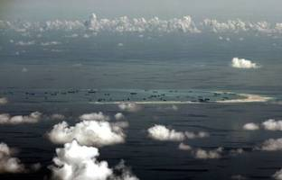 US Navy ship sails near South China Sea reef claimed by Beijing: US official