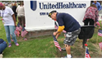 unitedhealthcare employees honor veterans by placing more than 1,800 flags in front of orange county offices