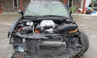 wrecked dodge charger hellcat shows up for sale, is full of bullet holes