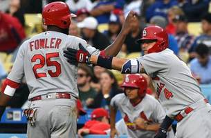 Cardinals take on NL-leading Rockies in Colorado
