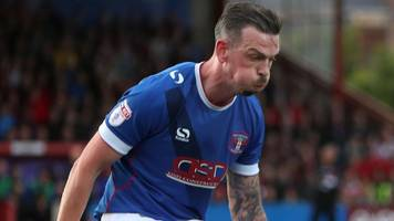 michael raynes: crewe alexandra sign carlisle united defender