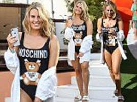 Danielle Armstrong wears Moschino swimsuit for Ibiza break