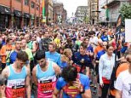 defiance of manchester: thousands take to streets for run