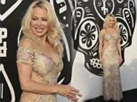 Pamela Anderson shows off famous curves in Marbella
