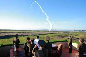 kim jong-un watches as north korea tests new anti-aircraft weapon