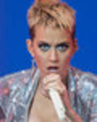 Katy Perry flashes knickers in spread-eagled exposé