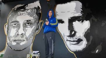 'belfast banksy' glen molloy unveils new artwork of carl frampton and liam neeson