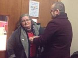 irish couple give pensioner a chinese at a bingo hall