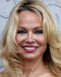 Baywatch boobs are back as Pamela Anderson rocks soaking wet see-through dress