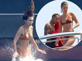 bella hadid alongside lewis hamilton in monaco