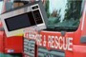 Fire crews called to microwave fire in Ernesettle home