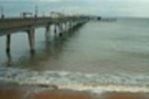 A 'headless' body has been discovered in the sea near Deal Pier