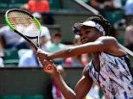 serena williams watches on as sister venus wins