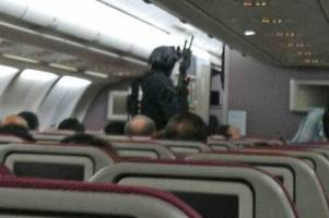 watch dramatic moment armed cops storm malaysian airlines flight to arrest 'bomb threat' suspect
