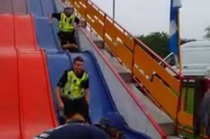 watch hilarious footage of fun-loving police scotland cops on 30ft slide at denny gala day