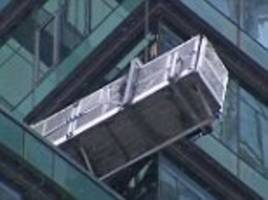 falling glass from newly opened trump tower in toronto