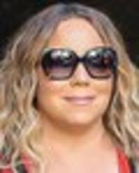 mariah carey teases indecent exposure with boob-spilling dress