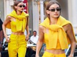 gigi hadid gives peek at toned tum in bright yellow number