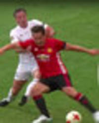 gary neville clattered by sky sports colleague jamie carragher in carrick testimonial