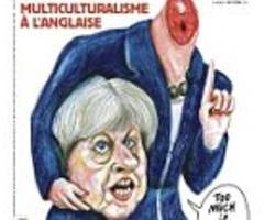 charlie hebdo shows decapitated theresa may on front cover