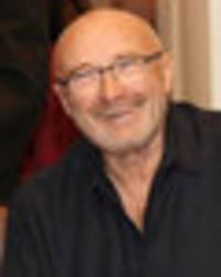 phil collins 'doing well' after serious head injury