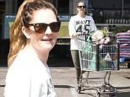 drew barrymore is casual chic as pushes cart of flowers