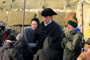 outlander's sam heughan sends fans into overload as he teases huge news on series three