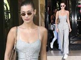 bella hadid flaunts her tiny waist in corseted jumpsuit