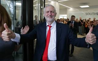 corbyn threatens may with a vow to amend queen's speech
