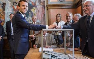 macron marches on with crushing parliamentary victory