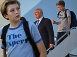 barron trump fiddles with fidget spinner on air force one