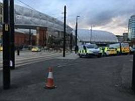 woman arrested after man is hit by manchester tram