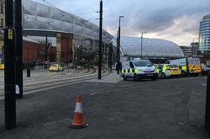 woman arrested on suspicion of murder after man hit by tram at manchester's victoria station