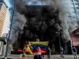 protesters set fire to government buildings in venezuela