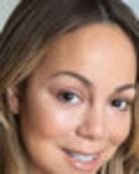 mariah carey strips to tiny knickers for peachy snap