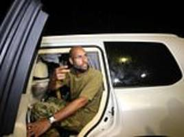 gaddafi's son wanted by icc for murder after he's 'free'