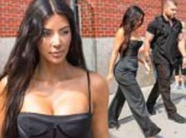 kim kardashian pours her curves into a bustier