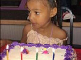 north west looks at her birthday cake